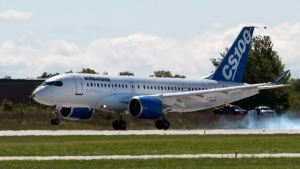 Bombardier's CSeries 100 touches down after its maiden test flight on, September 16, 2013 in Mirabel, Que. (THE CANADIAN PRESS / Ryan Remiorz)