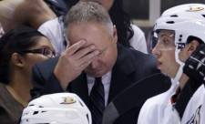 FILE - In this Sept. 23, 2011 file photo, Anaheim Ducks head coach Randy Carlyle put his head down during the third period of a preseason game against the San Jose Sharks.
