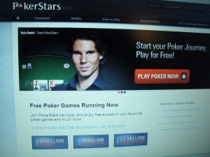 This Dec. 11, 2013 photo shows the home page of the PokerStars web site hours a computer screen in Atlantic City, N.J. (AP / Wayne Parry)