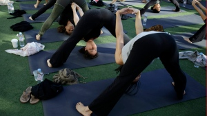 Yoga is one of the man methods one can employ to increase wellness over the holidays.(AP Photo/ Lynne Sladky)