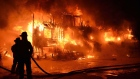 Fire engulfs a senior's residence in L'Isle-Verte, Que., early Thursday, Jan. 23, 2014. (Frances Drouin / THE CANADIAN PRESS)