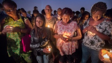 People attend a vigil in memory of the victims of