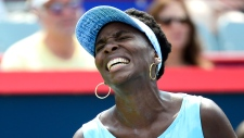 Venus Williams grimaces during the Rogers Cup fina