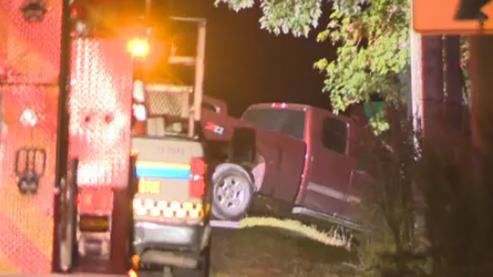 This pickup truck appears to have veered into a ditch to avoid hitting other vehicles (Aug. 11, 2014)