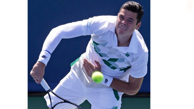 Miloa Raonic, from Canada, serves against Fabio Fo