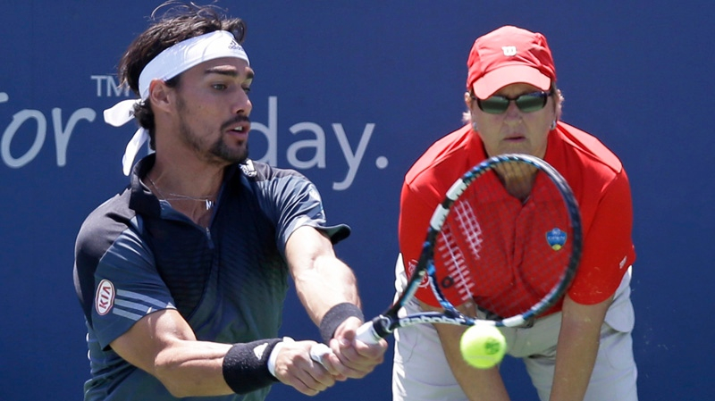 Fabio Fognini, from Italy, hits a backhand against Miloa Raonic, from Canada, during a match at the Western & Southern Open tennis tournament, Friday, Aug. 15, 2014, in Mason, Ohio. (AP Photo/Al Behrman)