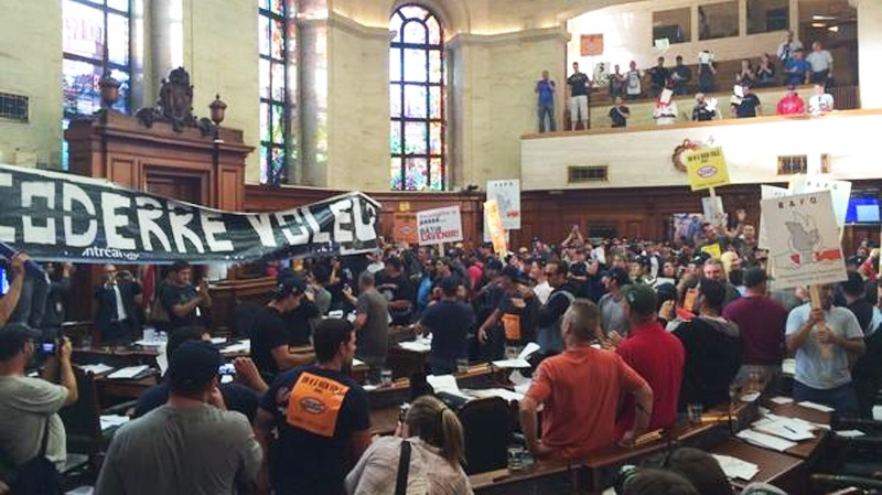 Protesters are seen inside council chambers Monday evening. (CTV Montreal Natalie Nanowski)