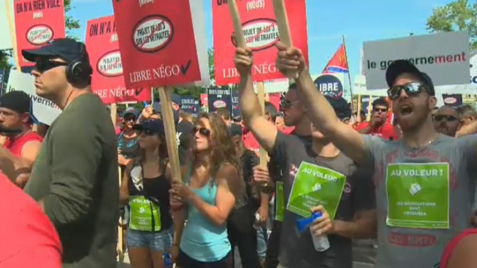 Unionized municipal workers protest Bill 3 in Quebec City on Aug. 20, 2014