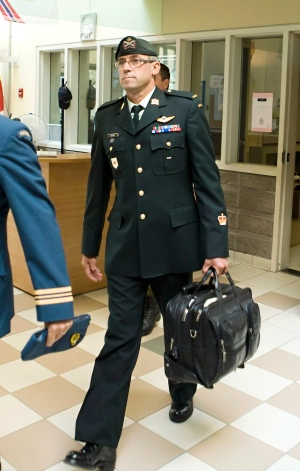Warrant officer Andre Gagnon walks to testify at his court martial at the St-Malo Armoury on Tuesday, August 12, 2014 in Quebec City. (Clement Allard / THE CANADIAN PRESS)