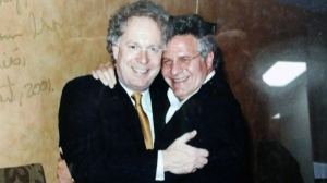 Jean Charest is seen hugging Tony Accurso at a fundraiser in 2001. (Charbonneau Commission handout)