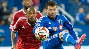 Montreal Impact's Jack McInerney, right, and San Jose Earthquakes' Pablo Pintos battle for the ball during secnond half MLS soccer action in Montreal, Saturday, September 20, 2014. THE CANADIAN PRESS/Graham Hughes