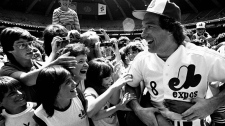 Montreal Expos catcher Gary Carter is mobbed by admiring fans at camera day prior to a baseball game against the Pittsburgh Pirates in Montreal on June 24, 1983. (AP / Bernard Brault)