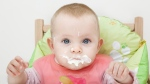 A child is shown with food on her face. (Patrick Breig / shutterstock.com)