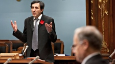 Quebec Solidaire legislature member Amir Khadir, left, tables a non-confidence motion against the government over the proposed tuiton hikes at the legislature in Quebec City, Tuesday, Feb. 28, 2012. (Jacques Boissinot / THE CANADIAN PRESS)