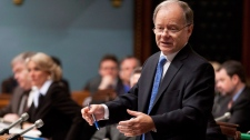 Quebec Finance Minister Raymond Bachand responds to Opposition questions Thursday, March 1, 2012 at the legislature in Quebec City.