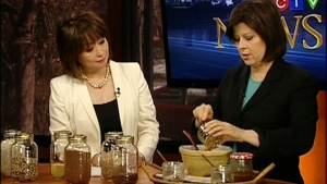 Susan Semenak shows Mutsumi Takahashi several ways of cooking quinoa (March 7, 2012)