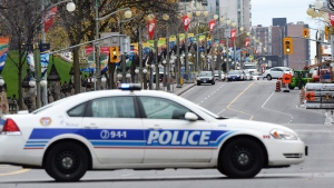 A police car blocks a street in Ottawa on Wednesday, Oct. 22, 2014. (Sean Kilpatrick / THE CANADIAN PRESS)