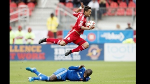 Toronto FC's Gilberto, top, leaps over Montreal Impact's Hassoun Camara after being tackled by the Montreal defender during the first half of an MLS soccer match, Saturday, Oct. 18, 2014, in Toronto. (AP Photo/The Canadian Press, Darren Calabrese, File)
