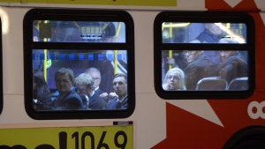 Conservative MPs are transported in an Ottawa transit bus from Parliament Buildings in Ottawa on Wednesday, Oct. 22, 2014. (Sean Kilpatrick / THE CANADIAN PRESS)