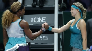 Serena Williams, left, of the US is congratulated by Canada's Eugenie Bouchard following their singles match at the WTA tennis finals in Singapore,Thursday, Oct. 23, 2014. (AP Photo/Mark Baker)