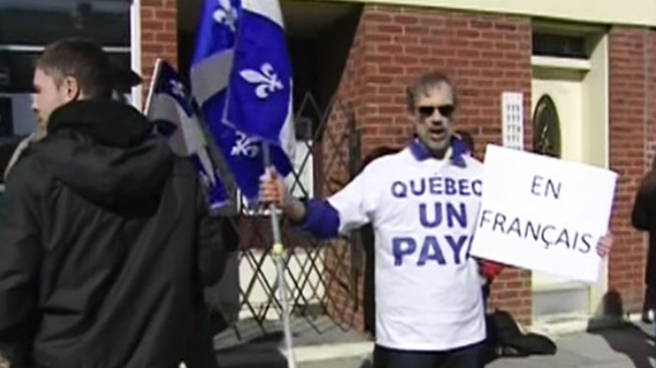 A Quebec youth group holds a protest outside of a variety store in Verdun, Que., on Tuesday, March 13, 2012.