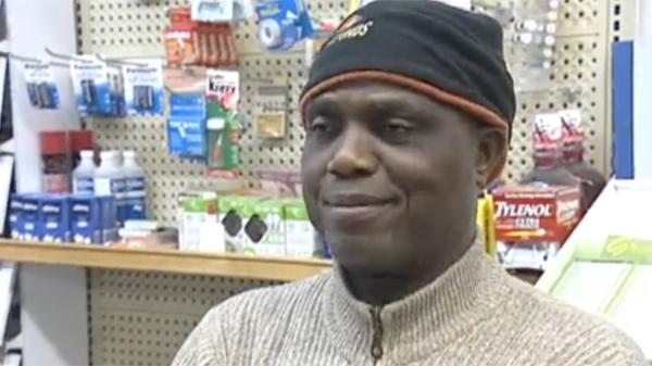 Anthony Williams has found dog excrement smeared on his store's windows since he got involved in a language dispute (March 14, 2012)