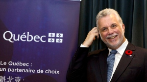 Premier of Quebec Philippe Couillard attends a signing ceremony between Canadian companies and their Chinese counterparts in Beijing, China, Wednesday, Oct. 29, 2014. (AP Photo/Ng Han Guan)