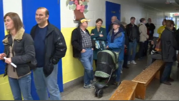 Long delays as voters cast their ballots in school board ...