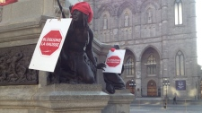 "As part of ""Red Wednesday,"" students put up red signs throughout Montreal. These are in Place d'Armes."