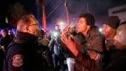 Protesters confront a police officer, in Ferguson, Mo., Tuesday, Nov. 25, 2014. (AP / David Goldman)