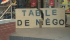 Montreal's police union uses a broken table to symbolize what has happened to negotiations (Nov. 26, 2014)