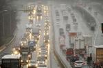 Traffic crawls along Interstate 95 as sleet falls during the beginning of a snow storm in Danbury, Conn. on Nov. 26, 2014. (AP / Jason Rearick)