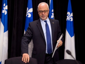 Quebec Finance Minister Carlos Leitao presents an economic update at the legislature in Quebec City on Tuesday, Dec. 2, 2014. (Jacques Boissinot / THE CANADIAN PRESS)