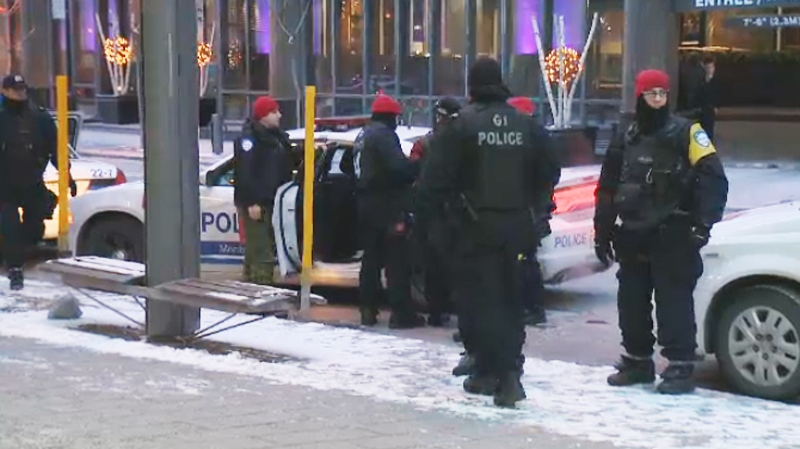 Police are seen handling a suspect at the demonstration in Montreal Monday. (CTV Montreal)