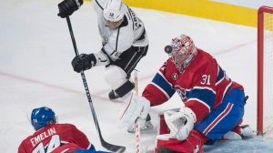 Montreal Canadiens goaltender Carey Price makes a save against Los Angeles Kings' Marian Goborik (12) as Canadiens' Alexei Emelin defends during first period NHL hockey action in Montreal, Friday, December 12, 2014. THE CANADIAN PRESS/Graham Hughes