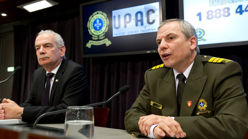 Robert Lafreniere, left, Quebec anti-corruption commissioner, and Denis Morin, head Quebec Provincial Police anti-corruption unit, comment on the 14 arrests made earlier with various counts of fraud Tuesday, April 17, 2012 in Montreal. (Paul Chiasson / THE CANADIAN PRESS)