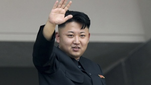 North Korea's leader Kim Jong Un waves to spectators and participants of a mass military parade celebrating the 60th anniversary of the Korean War armistice in Pyongyang, North Korea, July 27, 2013. (AP / Wong Maye-E)