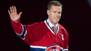 Former Montreal Canadiens captain Saku Koivu waves to the crowd during a ceremony honouring his career Thursday, December 18, 2014 in Montreal. THE CANADIAN PRESS/Paul Chiasson