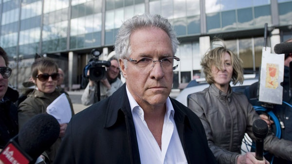 Antonio Accurso leaves the SQ headquarters in Montreal, Tuesday, April 17, 2012, after being arrested on charges relating to corruption. photo THE CANADIAN PRESS/Graham Hughes