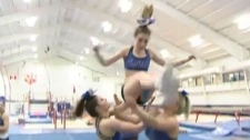Cheerleaders from Laval's CheerMotion Jags doing flips a week before the World Cheerleading Championships.