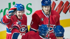 Montreal Canadiens' Alex Galchenyuk (27) celebrates with teammates Max Pacioretty (67), P.K. Subban (76) and Alexei Emelin (74) after scoring against the Ottawa Senators during third period NHL hockey action in Montreal, Saturday, December 20, 2014. THE CANADIAN PRESS/Graham Hughes
