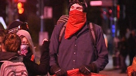A masked student take part in a march in downtown Montreal on Wednesday, April 25, 2012.