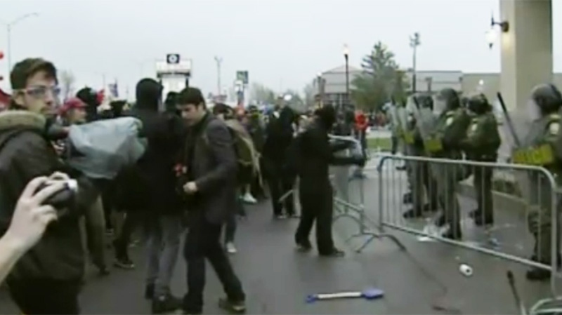The demonstrators advanced past the barriers Friday in Victoriaville, only to come face to face with SQ riot police.
