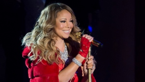 Mariah Carey performs at the 82nd Annual Rockefeller Center Christmas tree lighting ceremony in New York, Dec. 3, 2014. (Photo by Charles Sykes / Invision)