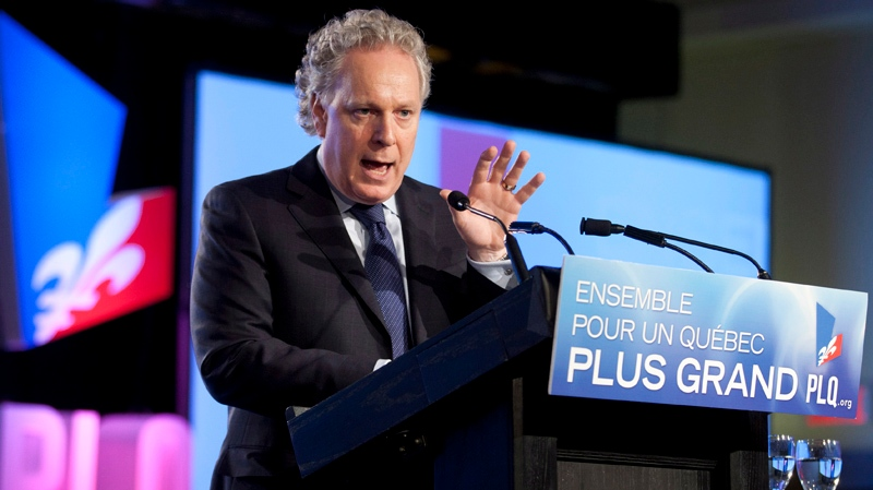 Quebec Premier Jean Charest speaks to delegates at the end of a Quebec Liberal Party meeting Sunday, May 6, 2012 in Victoriaville, Que. THE CANADIAN PRESS/Jacques Boissinot