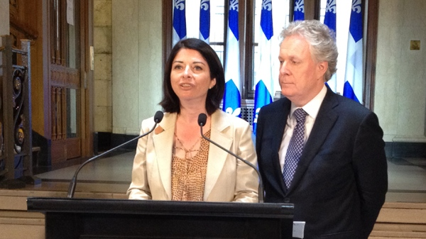 Education Minister Line Beauchamp announces her resignation from politics, while Premier Jean Charest looks on (CTV Montreal/Frederic Bissonnette, May 14, 2012)