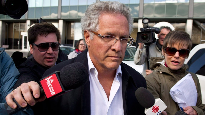 Quebec construction magnate Tony Accurso leaves the Quebec Provincial Police headquarters after being arrested for charges of fraud along with 13 others in Montreal, Tuesday, April 17, 2012.  (Paul Chiasson / THE CANADIAN PRESS)