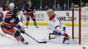 Montreal Canadiens goalie Carey Price (31) defends the net against a shot at goal by New York Rangers right wing Mats Zuccarello (36) during the second period of an NHL hockey game Thursday, Jan. 29, 2015 at Madison Square Garden in New York. (AP Photo/Mary Altaffer)