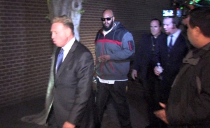 "This image from video shows Death Row Records founder Marion ""Suge"" Knight, right, walking into the Los Angeles County Sheriffs department early Friday morning Jan. 30, 2015 in connection with a hit-and-run incident that left one man dead and another injured. (AP/OnSceneVideo via AP Television)"