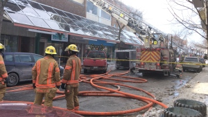 Over 100 firefighters at the scene on St-Hubert Street for a blaze that broke out at around 11 a.m. on March 5, 2015.
